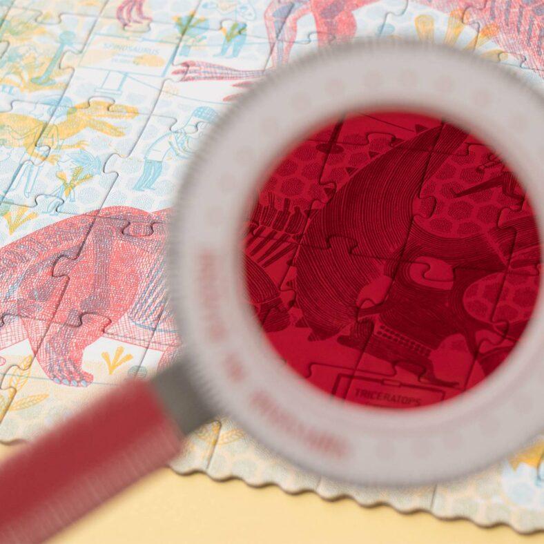 puzle descubre los dinosaurios lupa roja huesos