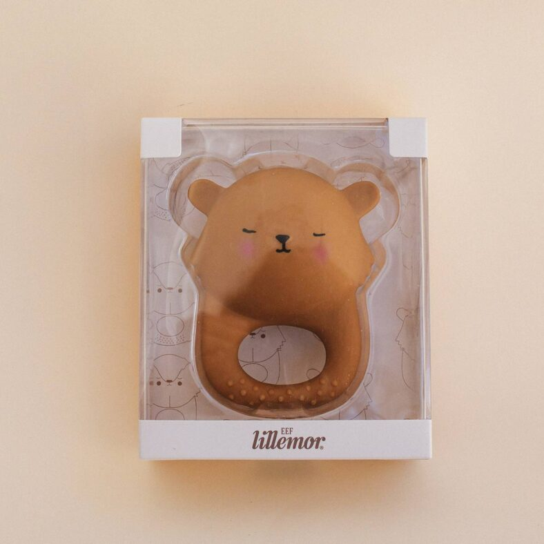 Mordedor león de caucho packaging