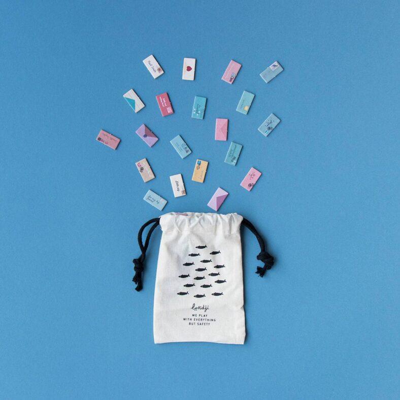 bolsa con piezas juego de mesa postman version viaje pocket