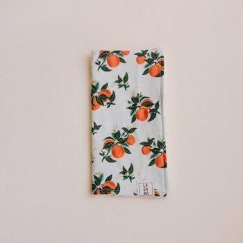 toallita paño lactancia naranjas doblado mitad